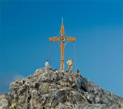 Summit cross with mountain peak